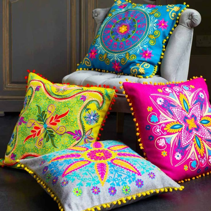 """Felt Embroidered Gypsy Cushions ~ """"Add instant warmth to your room with these gorgeous, vibrant cushions. A harder wearing alternative to our cotton version, these square embroidered gypsy cushions with pom pom trim are inspired by Indian tribal patterns and prints."""""""