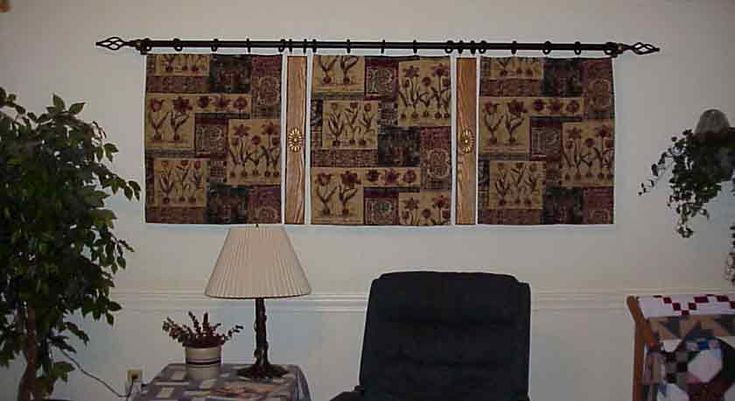 you could hang anything from a curtain rod, anywhere. I am thinking a long shear curtain behind a bed, from the top of wall.