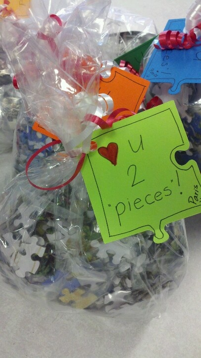 """Love you two pieces"". Always looking for small gift ideas to brighten someone's day or to say thank you. Found a box of puzzles on clearance. Took the pieces and wrapped them in a cellophane bag with the picture of the puzzle folded inside the bag. Used my cricut machine to cut the puzzle piece and tied together with ribbon. They were a big hit!"