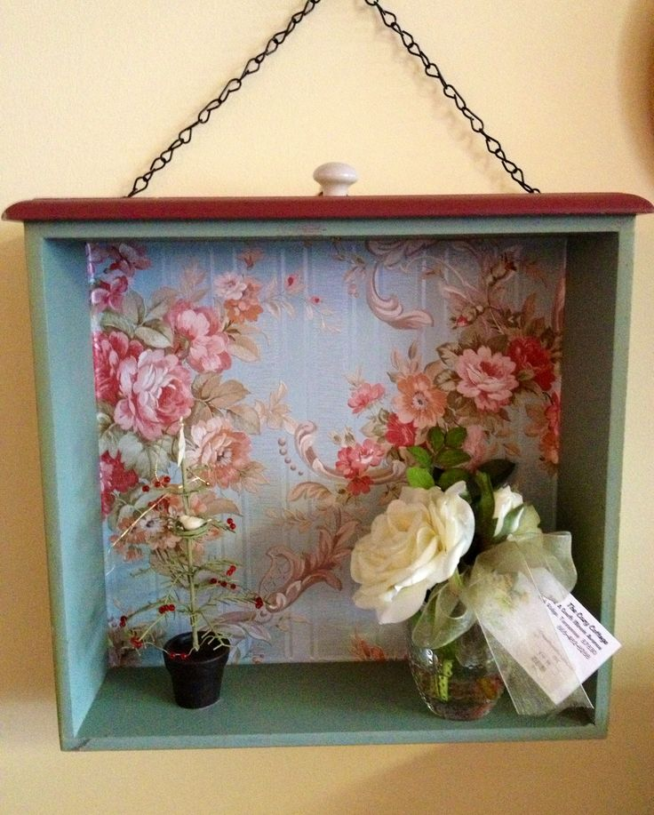 Recycled old drawer with wallpaper.                                                                                                                                                                                 More