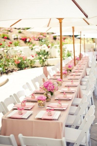 Use an ice or light pink linen and white wood folding chairs to achieve this soft, romantic look.