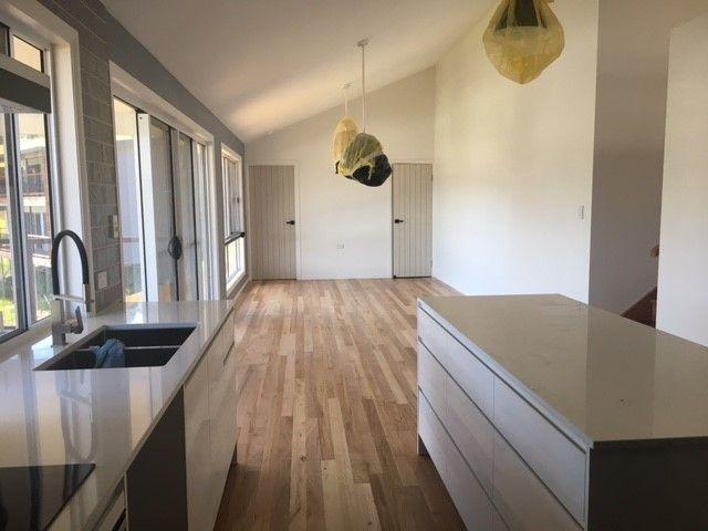Open plan living/Kitchen with real timber floors | Tru-Built Builders Queensland.