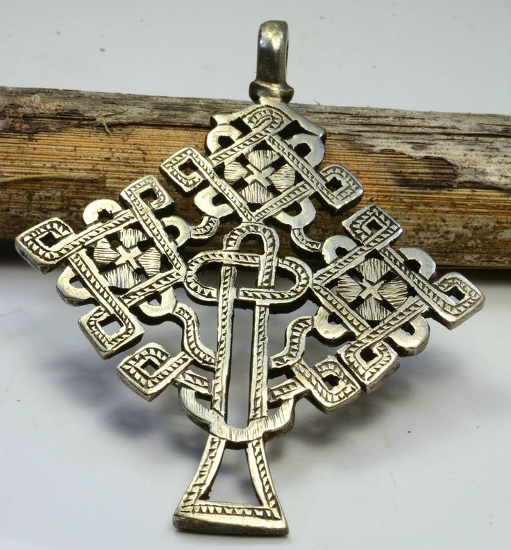 This is New cross , The cross Decorated both side havey and Thickness , Great lines ,Spectacular Design , Huge rare and Uniqe! made by Ethiopian silversmith. The Pendant was Create with lost wax method as anciat times.