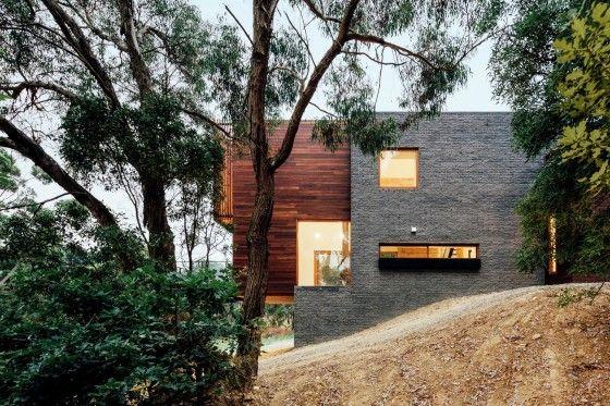 Fachada de hormigón y madera casa moderna