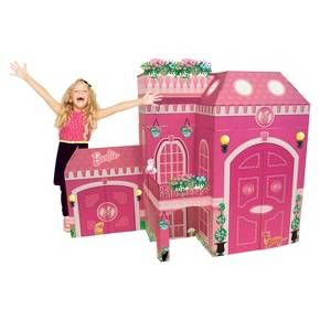 """The Full Size Barbie Play House with Stickers is a dream house come true for all little Barbie lovers! At 52"""" inches, the Full Size Play House stands over 4' tall when assembled, and is a designed so girls and dolls can play together. These beautiful castles are sturdy, fully printed cardboard structures that include repositionable stickers so girls can decorate their own house. There are balconies and doors for dolls as well as a life size door and shelves for girls. ..."""