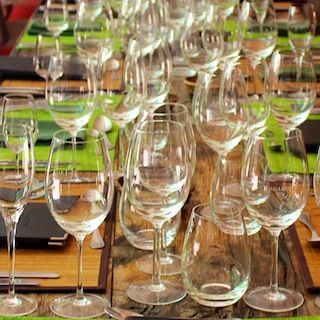 This is how we roll in Mendoza. Table is set for lunch. So many glasses!