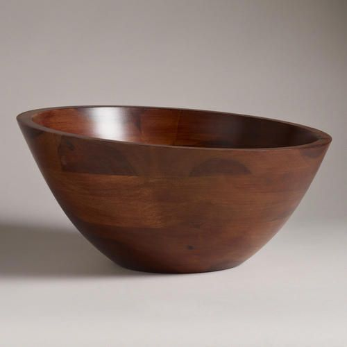Striking from every angle, this distinctive and generously-sized Angled Wood Salad Serving Bowl provides a fresh perspective in serveware. Sheesham wood in rich, natural tones and flowing wood grain creates an elegant combination for presenting a lush salad or pasta at the dinner table.