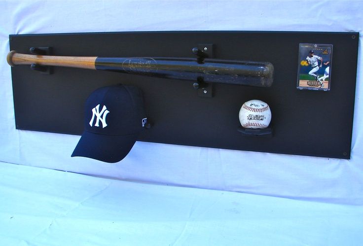 Ultimate Baseball Display on Amazon.com , it uses your baseball bat, baseball, trading card and a baseball hat. $69.99 plus shipping