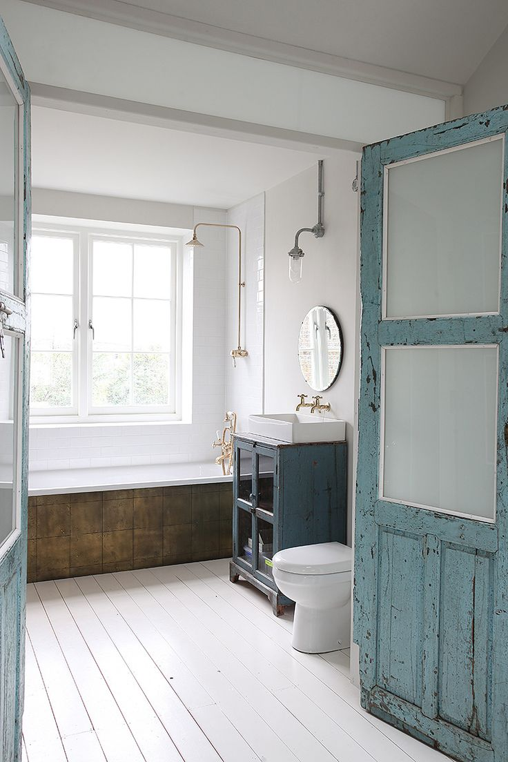 143 best inspiration bathroom images on pinterest room bright bathroom with a white wooden floor and a blue wing door we love the