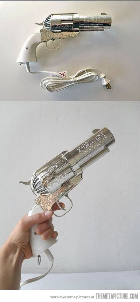 drying up hair with a GUN..? :O