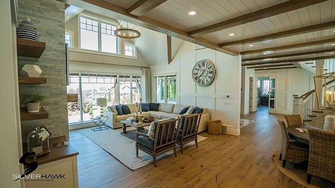 Living Room The Features A Tall Stone Fireplace Flanked By Built Ins With