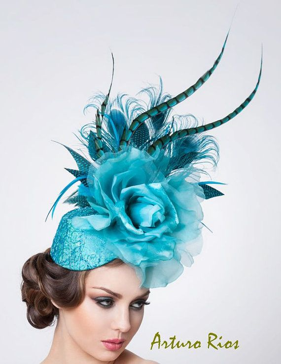 Melbourne Cup Hat: Oval base covered with silk & metallic net & sequins, embellished with silk rose & peacock, rooster, goose & pheasant feathers.