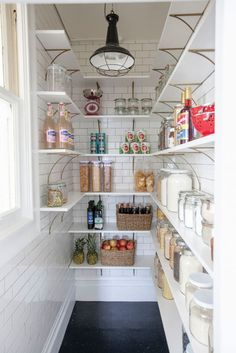 Attention Fixer Upper fans—the subway title in this pantry is right up your alley.