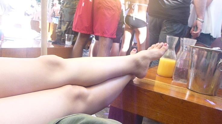 Linda's feet at a pool party