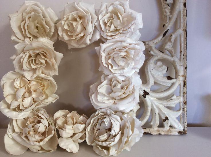 "DIY ""plaster flowers"" frames."