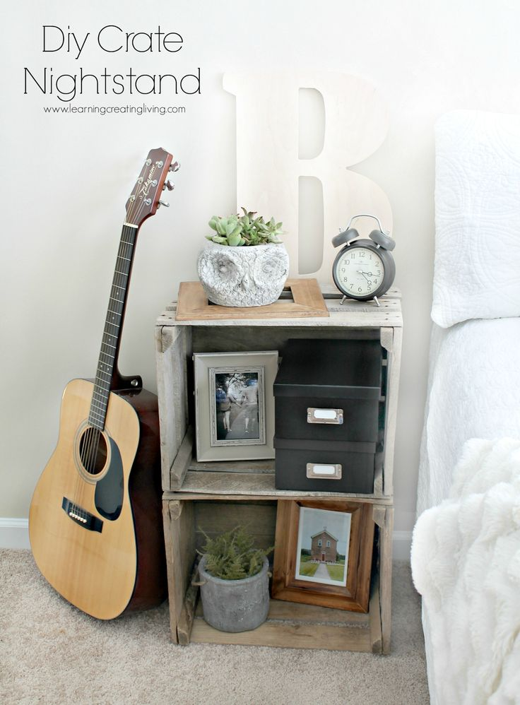 DIY Crate Nightstand - literally just put two wooden crates on top of each other. Easy, simple, and looks good!
