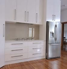 White Kitchen Splashback Ideas could just go the wall colour under glass! - modern kitchen