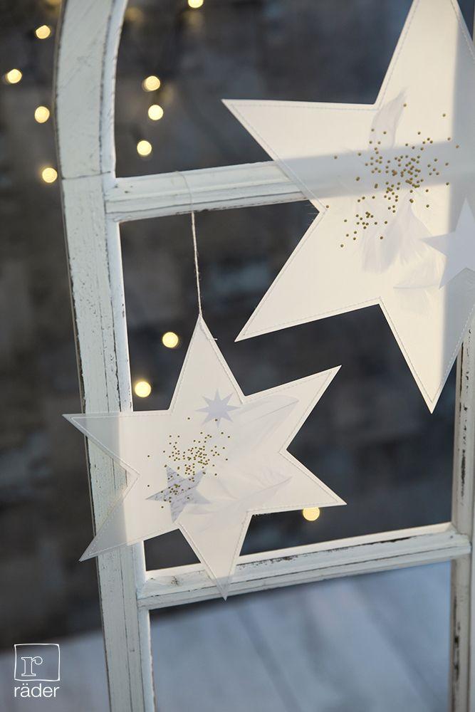 Transparent Sterne von räder, gefüllt mit Elementen aus Papier und echten Federn, mit silberner oder goldener Heißsiegelung.