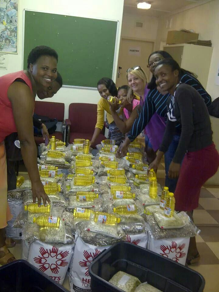 Carol Wessels and Onecity packing food parcels for a community called Chesterville