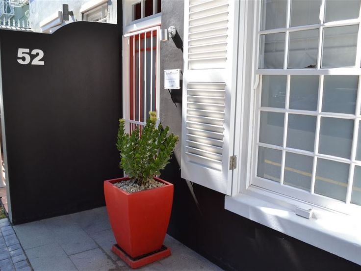 52 Loader Street - Located at the quieter end of Loader Street and tastefully designed, this home is ideal for couples or small families.It has two air-conditioned bedrooms and one shared bathroom. The red entrance hallway ... #weekendgetaways #dewaterkant #capetowncentral #southafrica