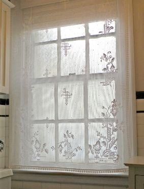 formosa lace curtain panel on a bathroom window