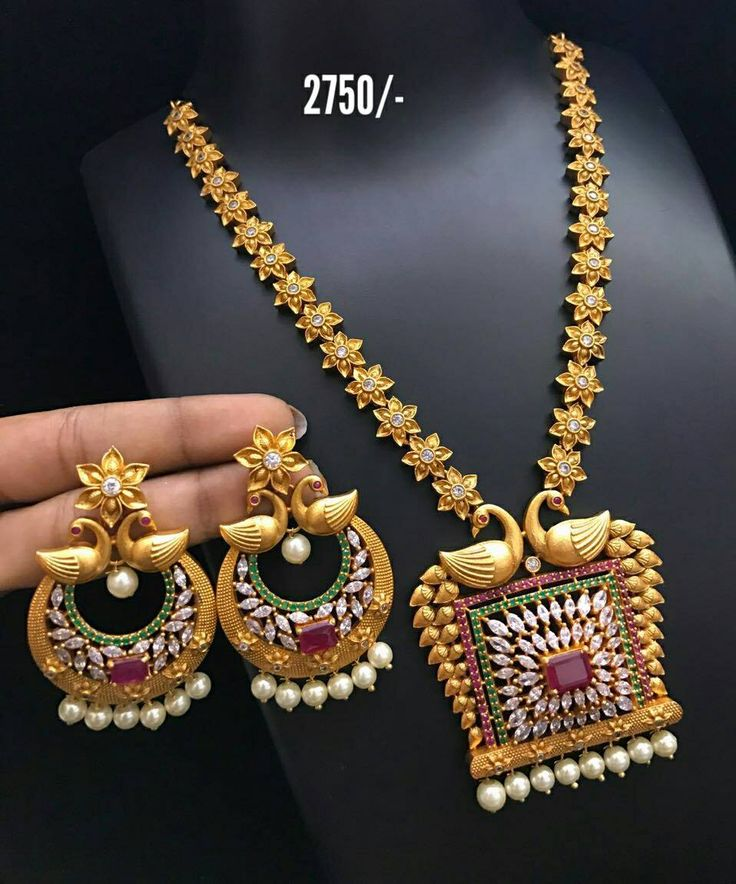Beautiful long haaram with star design. Long haaram studded with multi color stones. Long haaram with swan design pendant.