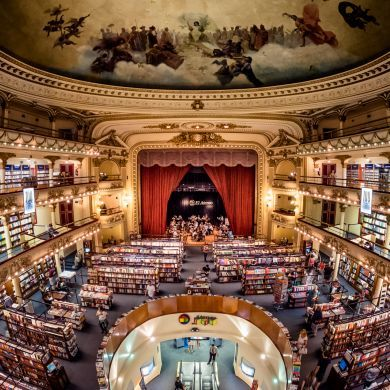 Libreria El Ateneo (Grand Splendid): Location: Buenos Aires, Argentina  The building was designed by the architects Pero and Torres Armengol for the empresario Max Glucksmann (1875-1946), and opened as a theatre called Teatro Gran Splendid in May 1919. The ecleticist building features ceiling frescoes painted by the Italian artist Nazareno Orlandi and caryatids sculpted by Troiano Troiani. With each incarnation since its inception in 1919 -- first as a performing arts theater, then as a…