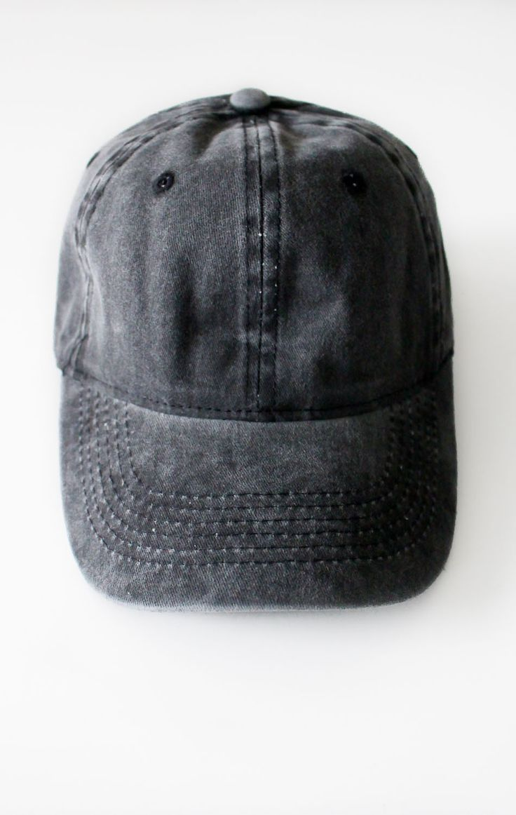 - Description Details: Vintage washed six panel cap in black with adjustable back with tri-glide buckle. 35% Cotton, 65% Acrylic. Imported Sizing: Adjustable, 2 1/4 x 4 1/2 Care: Machine wash cold