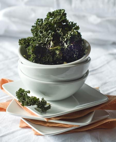 Salt & Vinegar Roasted Kale Chips   1 bunch kale, washed and dried well  1 tablespoon olive oil  1 ½ teaspoons apple cider vinegar  Kosher or sea salt to taste - oven to 300. Toss in a large bowl with oil and vinegar. Lay kale on prepared baking sheets in a single layer. Sprinkle with salt. Bake for 20 minutes or until crisp