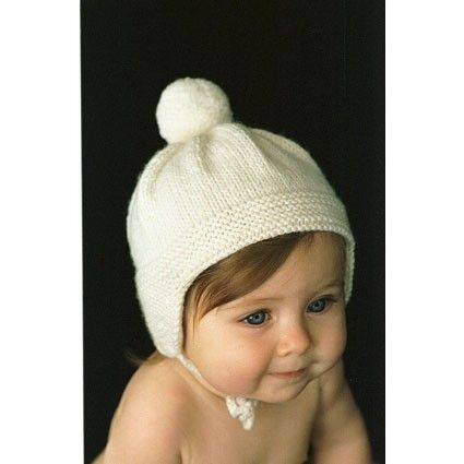 Pompom baby cap pattern by She is Crafty Handknits (magpiepatterns)