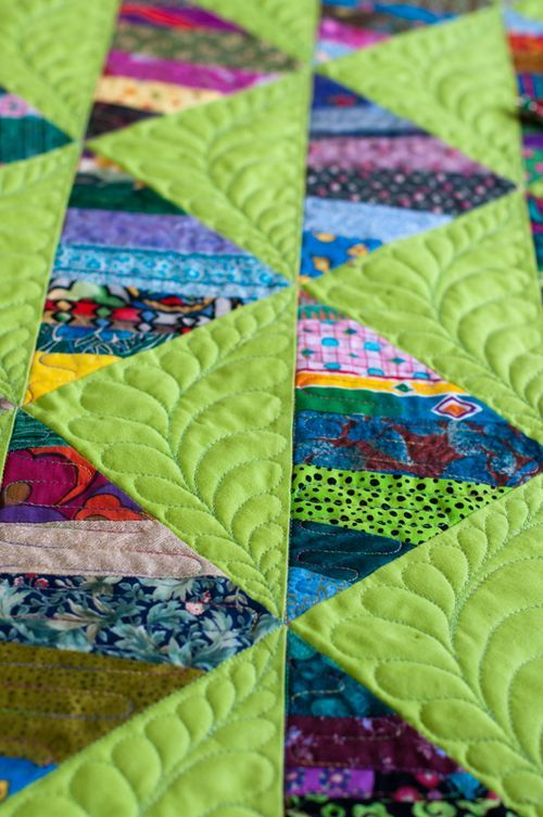 Quilting feathers on a strip quilt.  How-to by Lynn Harris at The Little Red Hen
