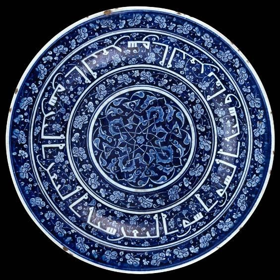 "Dish with calligraphic decoration Turkey, ""Iznik"", c. 1480 Stonepaste, siliceous underglaze painting over a siliceous slip coating H. 7.5 cm; Opening Diam. 37 cm; Base Diam. 23.2 cm -- Musée du Louvre."