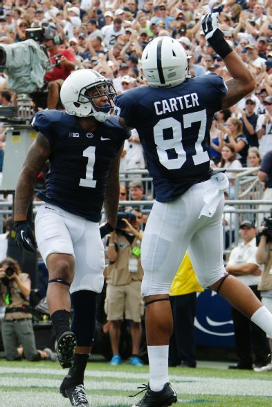 PENN STATE – FOOTBALL 2014 – Penn State 's Bill Belton (1) celebrates with teammate Kyle Carter (87) after scoring a touchdown on a pass from quarterback Christian Hackenberg during the first quarter of an NCAA college football game against Akron in State College, Pa., Saturday, Sept. 6, 2014. (AP Photo/Gene J. Puskar)