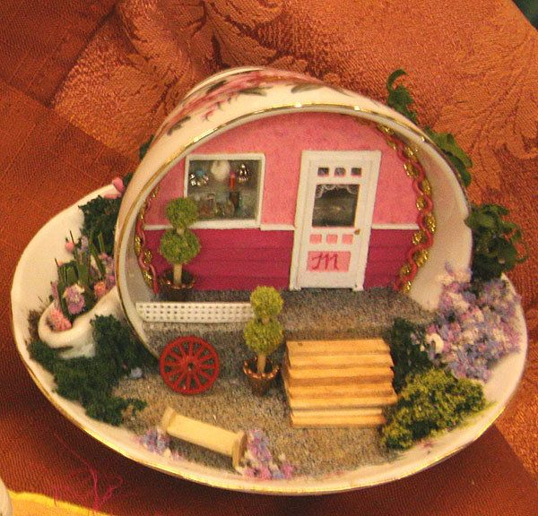 teacup house :-) http://0.tqn.com/d/miniatures/1/0/l/q/-/-/johnsontcup.jpg