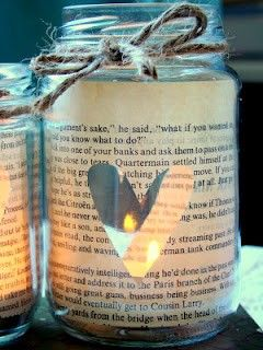 Book pages and candles inside a Mason jar!    Love this idea. I guess you could do it with any kind of picture or fabric. I would be a bit scared for burning risks...