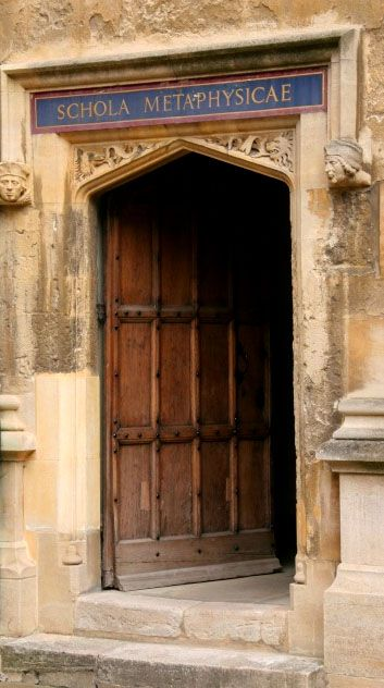Doorway to the School of Moral Philosophy at the Bodleian Library at University of Oxford, one of the oldest libraries in Europe.  Contains 11 million items on117 miles of shelving.  Ohhhh, to peek inside. . . .