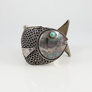 Description Vintage Sterling Fish Cuff …Whimsy on the line…your wrist captured like your imagination…Hook, Line, and Sinker…! Country of Origin:Peru Circa:Likely 1950′s Total Inside Circumference:7″ Gap Opening Width:1″ This Bracelet Will Comfortably Fit: 6 3/4″ – 6 7/8″ Wrist Bracelet At Widest Point:2 1/8″ Total Weight:55.7 Grams = 1.79 Troy Oz. Clearly Marked:925 Total Item … … Continue reading →