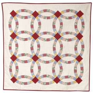 Beautiful double wedding ring quilt Sew blocks together in rows and columns Quilt and bind
