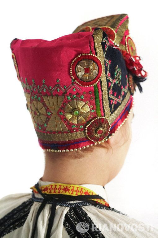 "Russian national costume. The Collection Of Sergey Glebushkin.  ""Soroka"" - headgear of the married women. According to ancient traditions, a woman, unlike the girls, the hair should be neatly removed."