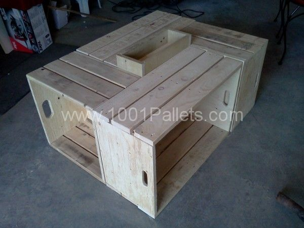 Wooden pallets for your living room table. The 4 sides it gives to the table is interesting !