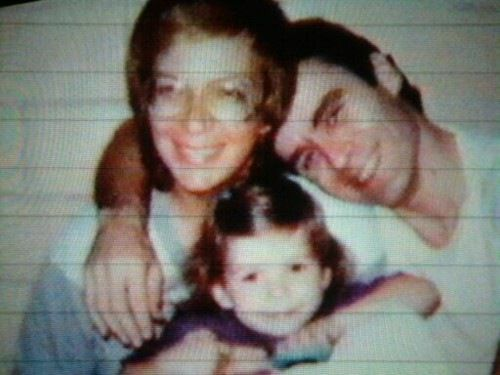 Carol Boone, Ted Bundy, and their daughter, conceived on the sly in the prison visiting room.