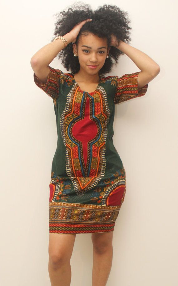 This stunning pencil dress features a modern dashiki designed neckline and short…