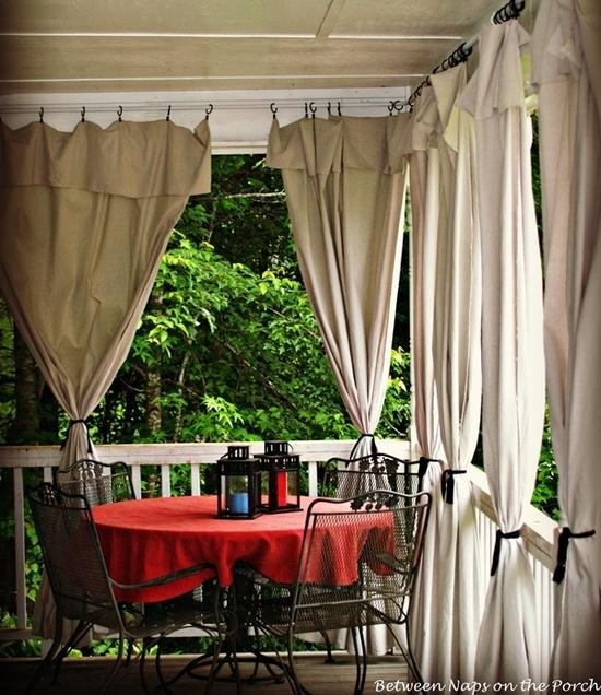 Add Curtains to a Porch for Privacy Sun Control - 6x9 drop cloths turned down at top; 1/2 inch electrical conduit pipe for curtain rod; Mainstay Clip Rings