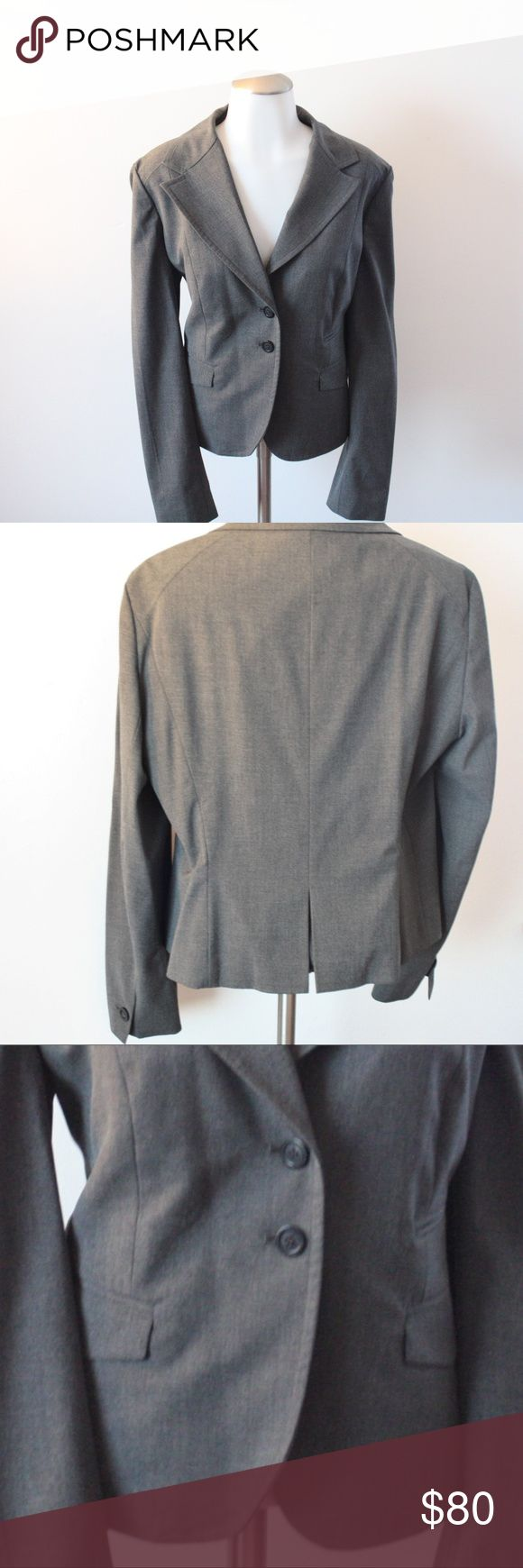 Size 14 Michael Kors Charcoal Gray Blazer Jacket In like new condition! Michael Kors Charcoal Gray Blazer Jacket - Size 14. This beautiful blazer has 2 pleated pockets. Looking at the blazer, the right pocket has another pocket above it that is a half closed (if you want that as a full pocket, it's an easy seam snip!. 2 front buttons & 1 button on each cuff. Curved Blazer. Michael Kors Jackets & Coats Blazers