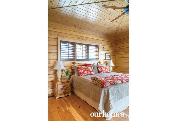 """This master bedroom has a wide view of the rock cliff and double-doors that open to the Muskoka room.    See more of this home in """"Fifth Generation Legacy on Muskoka's Moon River"""" from OUR HOMES Muskoka Early Summer 2017: http://www.ourhomes.ca/articles/build/article/fifth-generation-legacy-on-muskokas-moon-river"""