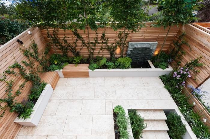 Jura Beige Limestone Paving is used in this modern back garden to create the feel of a larger space instantly.