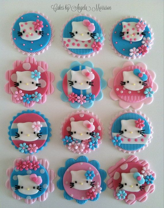 Turquoise and pink hello kitty toppers by CakesbyAngela on Etsy