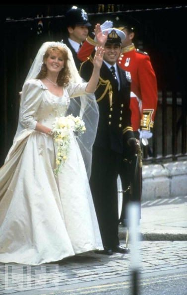 Fergie and the Prince Andrew wave to the crowd outside Buckingham Palace on their wedding day, July 23, 1986. Britain's Duke and Duchess of York would remain married for 10 years.