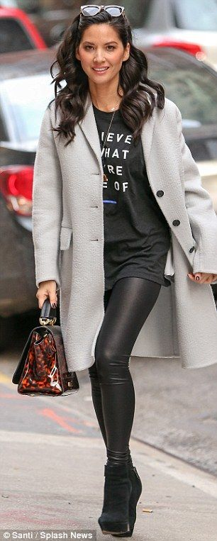 Quick change: After the taping, Olivia opted for a more casual look wearing a printed T-shirt, long grey cardigan and a pair of leather leggings