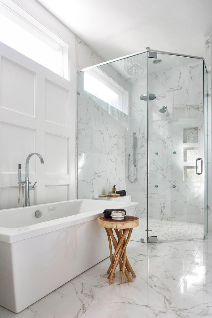 This master bathroom was renovated to include a large, curbless shower in  the corner,